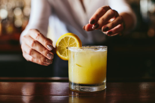Citrus Cocktail Being Made By Bartender