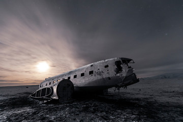 Sunset over damaged plane