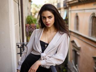 Sensual lady standing on balcony