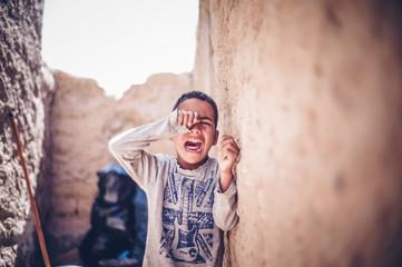Moroccan boy crying