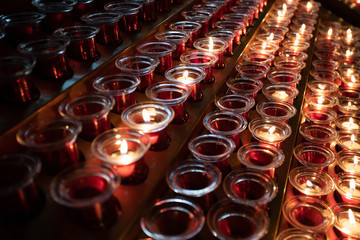 red and yellow candles in the church