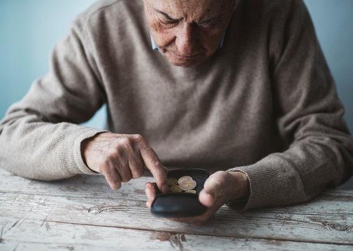 Senior man holding a wallet