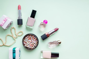 Accessories for women's beauty. Make up brush, nail polish, perfume bottle, all on pastel background,copy space. Minimalist cosmetics background.woman's jewellery.Professional female makeup Wall mural