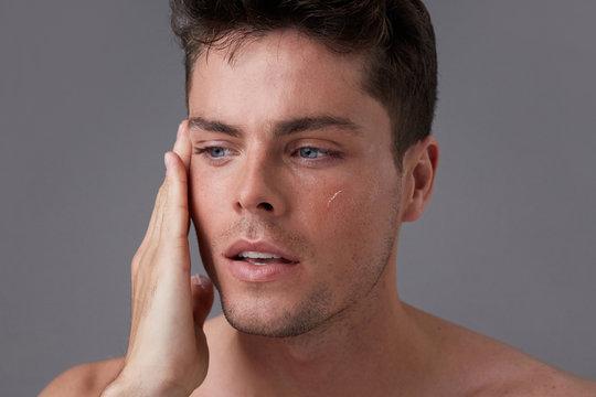 Man hydrating skin
