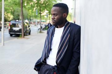 Ethnic afro businessman waiting street.