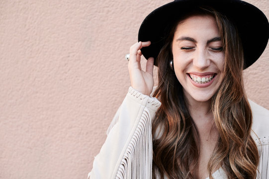 Brunette young woman portrait laughing.