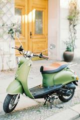 Foto op Plexiglas Centraal Europa scooter parked near the door
