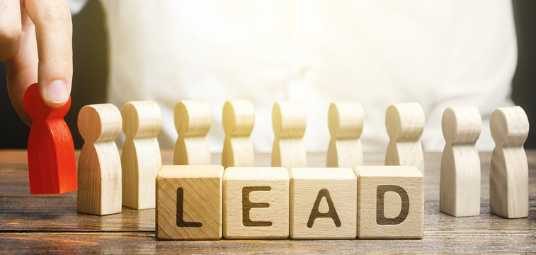 Man puts a leader at head of line of people. Project leadership. Appointment to a responsible post, strategic management planning. Distribution business optimization. Career promotion to leading post.