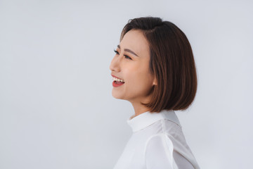 Side view profile of smiling asian woman face portrait.