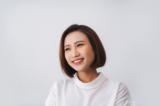 Portrait of beautiful young asian woman happiness standing on gray