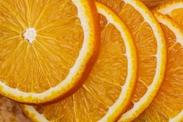 Sliced oranges close-up Abstract background with citrus-fruit