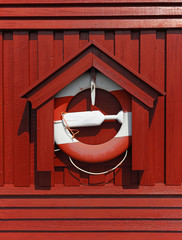 Life buoy on wooden cabin