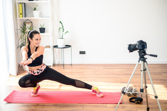 A woman is training and recording tutorial video