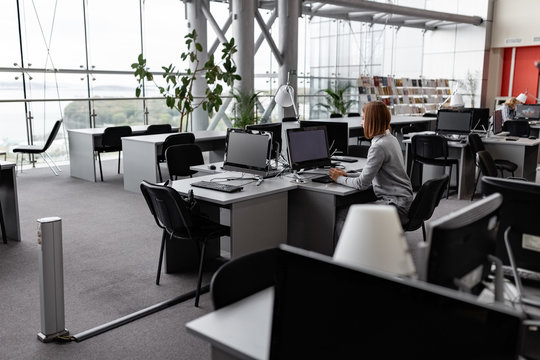 Woman studying in library computer class