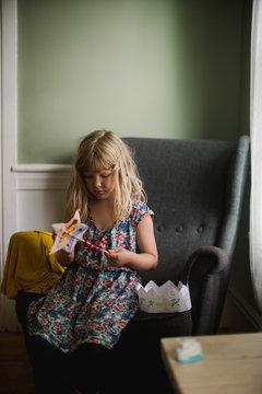 blonde girl sitting