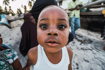 Zanzibari boy face with his beautiful eyes and her curled lashes