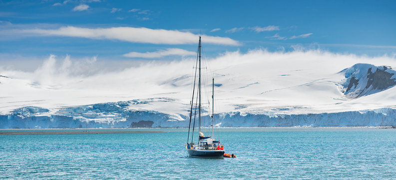 panoramic view to yacht into harbour in Antarctica