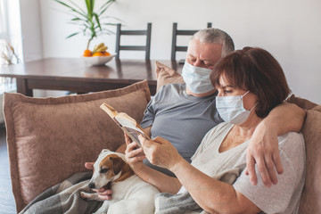 Elderly couple in medical masks during the pandemic coronavirus