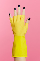 Painted nails and rubber glove