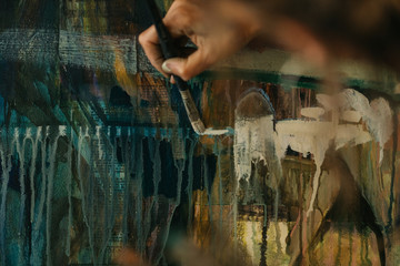 Artist woman drawing in her studio.
