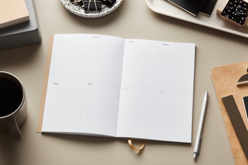 Layout of office supplies with clean notepad