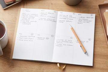 Arrangement of planner with weekly tasks