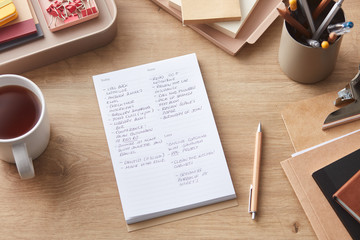 Composed notepad with mug and office supplies