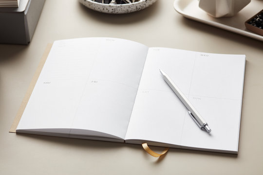 Blank planner with silver pen