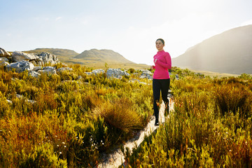 Fit attractive woman running in nature