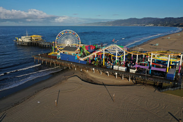 The Santa Monica pier and beaches on the Pacific Ocean are empty after California issued a stay-at-home order due to coronavirus disease (COVID-19) in Santa Monica