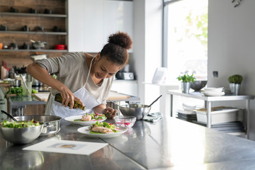 Woman cooking during a kitchen class