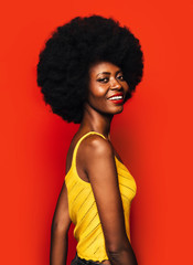 Happy Afro Woman posing over red background