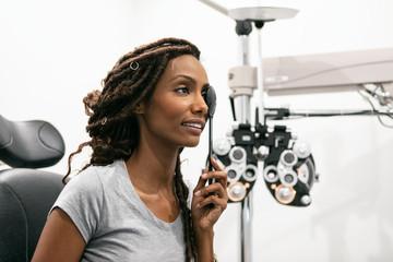Eyewear: Woman Uses Eye Occluder During Exam
