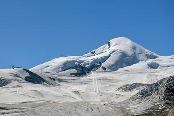 Wall Mural - View on summer skiing resort under Allalin peak above the Saas-Fee village