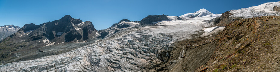 Wall Mural - Panoramic view on melting Fee glacier above the Saas-Fee village