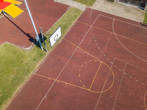 Aerial view of empty basket ball court. Concept of college school sports activity.