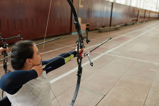 Disabled Woman Training Archery Skill