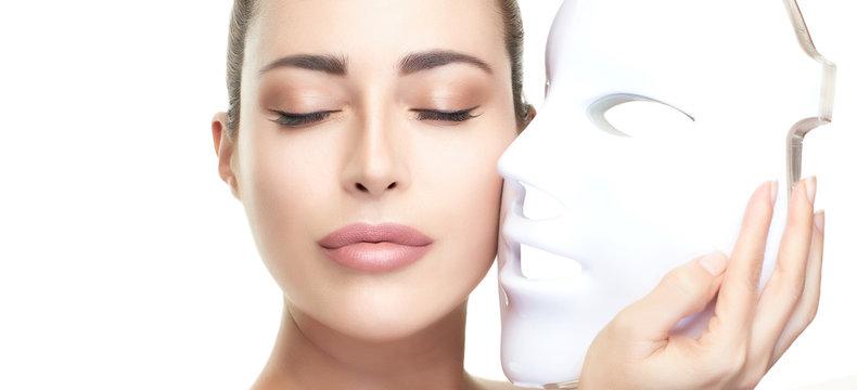 Beauty model woman with led mask. Photon therapy light treatment skin rejuvenation led facial mask