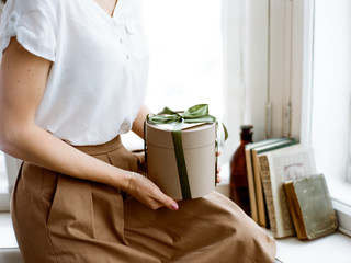 Woman with small gift box