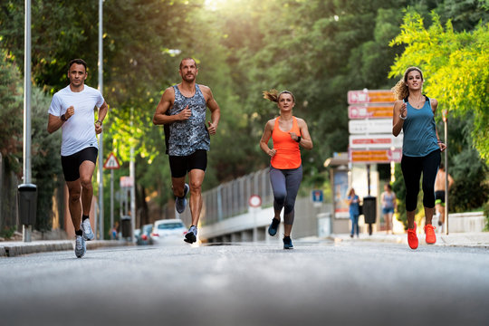 Athletes running in the street