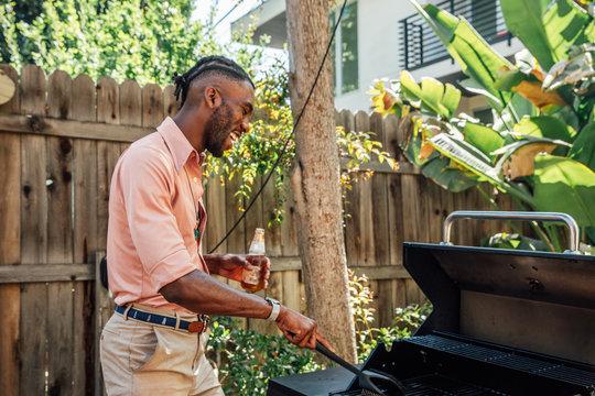 African American Man Grills