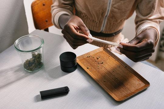 Closeup of Woman Rolling CBD Joint