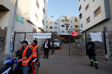 A police officer uses a megaphone advising residents to stay at home, following the coronavirus disease (COVID-19) outbreak, on the outskirts of Casablanca