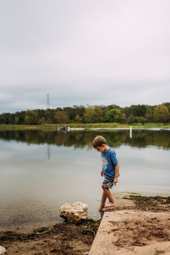 Young Boy Dipping Toes in the Water at Lake Bastrop