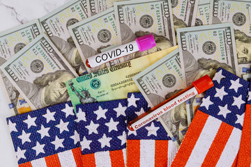 Coronavirus financial relief checks from government USA dollar cash banknote on American flag Global pandemic Covid 19 lockdown