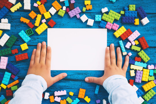 Сolourful creative children's background with colored toy bricks
