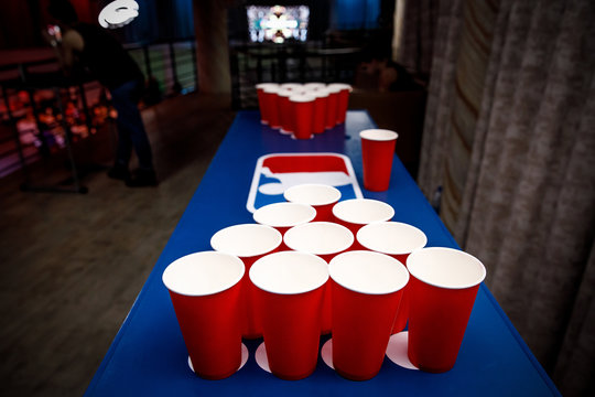 Red cups set for beer pong.