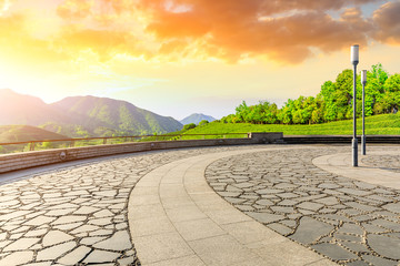 Foto auf Leinwand Gelb Schwefelsäure Empty square floor and green tea mountain nature landscape at sunset.