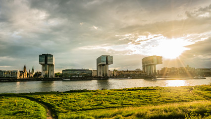 Crane houses by the Rhine at the sunset with green grass foreground
