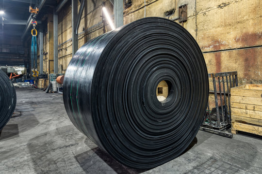 Large and heavy roll of conveyor belt.